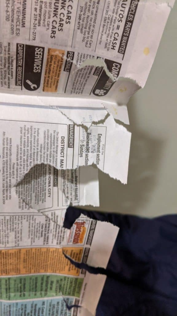 torn newspaper for fire starter
